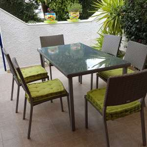 Sold: Rattan style table and six chairs