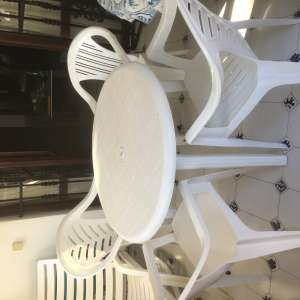 For sale: white patio table and 4 chairs...€30....as new