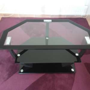 For sale: Smoked glass corner TV stand 60 euro - €60