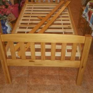 For sale: solid pine bed hardly used