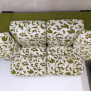 For sale: 2 seater green and cream fabric sofa