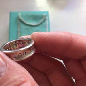 For sale: Reduced by €50 for quick sale. Wide band concave Tiffany 1837 ring