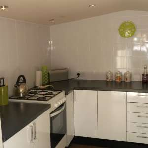 For sale: A beautiful white gloss kitchen