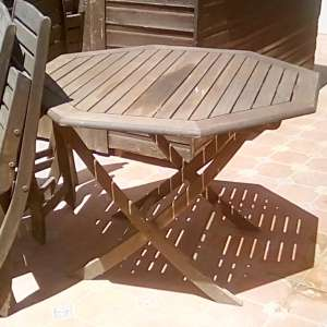 For sale: Wooden outside table and five matching chairs - €50