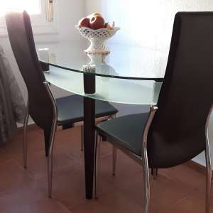 For sale: Modern dining table and 4 chairs - €100