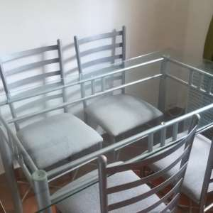 For sale: Glass top table and 4 chairs - €45