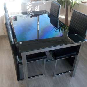For sale: Tempered black glass dinner table and high back chairs reduced to sell 24 hours left 100 euro!!!