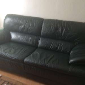 For sale: 2dark green leather sofas, 1 two seater and 1 three seater