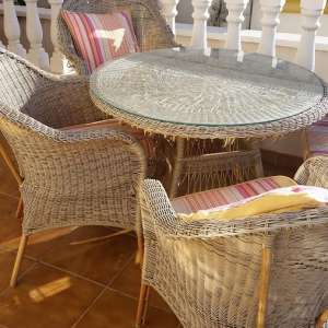 For sale: Garden table with four chairs and cushions